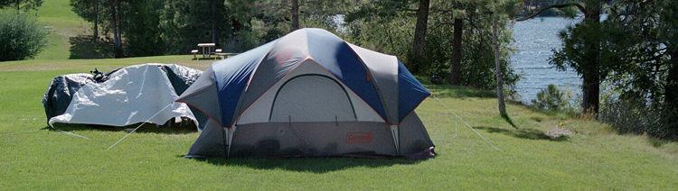 Tent on grassy knoll at Curlew Lake State Park.