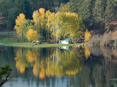 Cabin and trees with autumn foliage at Curlew Lake, WA