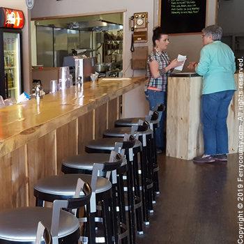 Bar seating at Pearl's Smokehouse restaurant.