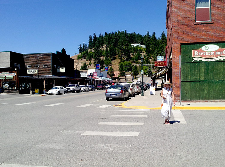 Woman walking down Clark Ave. in downtown Republic, WA.