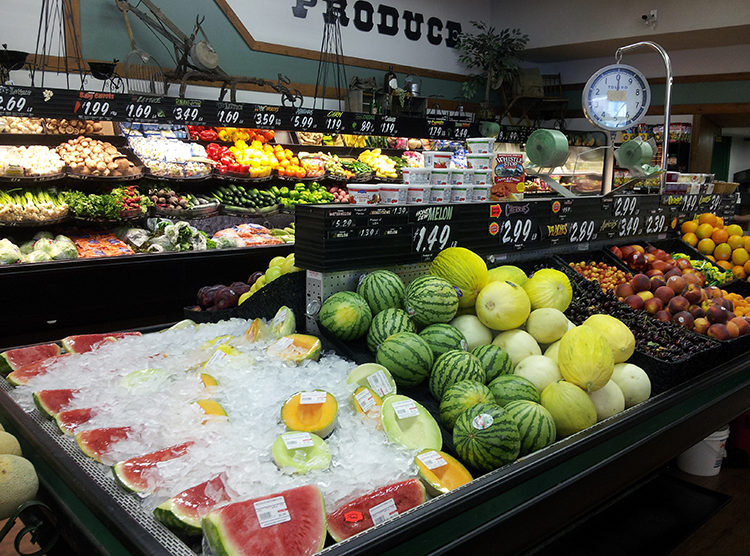 Produce section of Anderson's Grocery in Republic, WA. Melons in foreground.