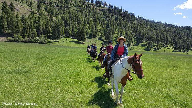 Line of horseback riders at K-Diamond-K Guest Ranch.