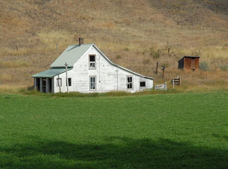 Abandoned, white farm house at Karamin, WA.