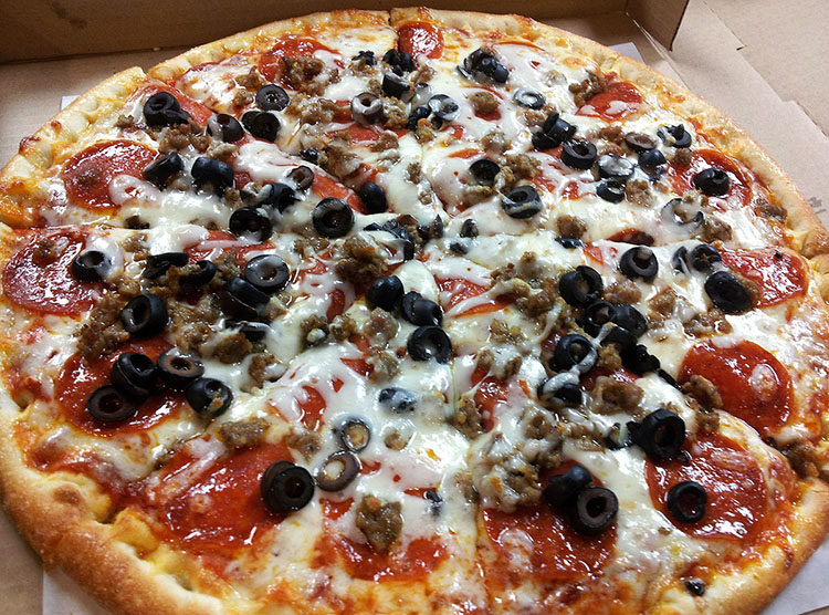 Republic Pizza's RPC Special with sausage, pepperoni, black olives, and cheese.