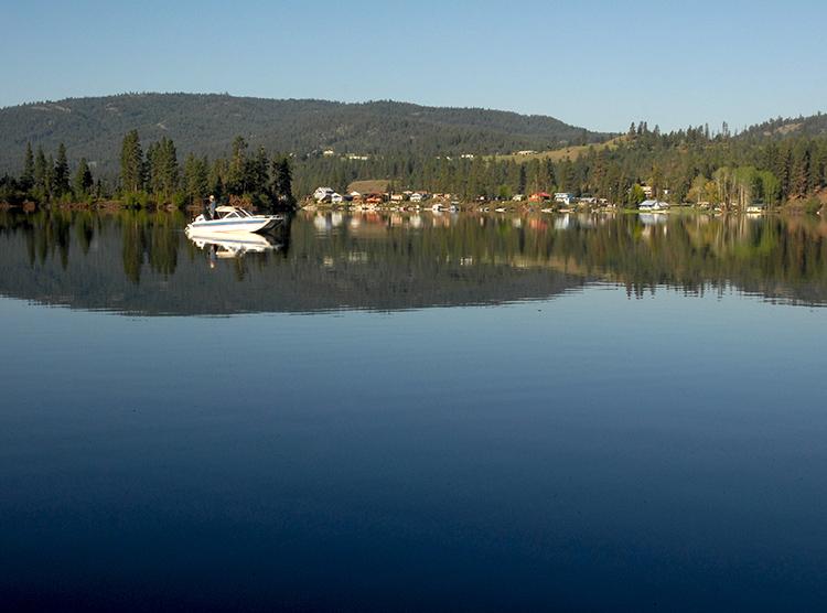 Fisherman and boat on Curlew Lake, WA