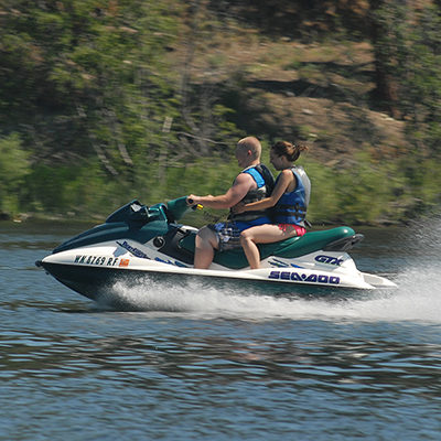 Two riders on personal watercraft riding down Curlew Lake,WA.