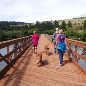 Friends, family, and pets crossing the trestle on the Ferry County Rail Trail.