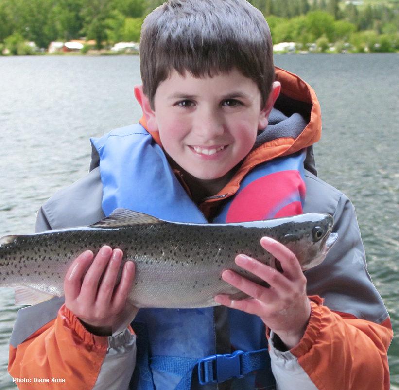 Boy holding trout. Photo: Diane Sims