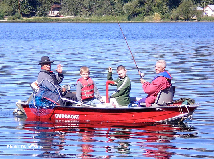 Family fishing together on Curlew Lake.